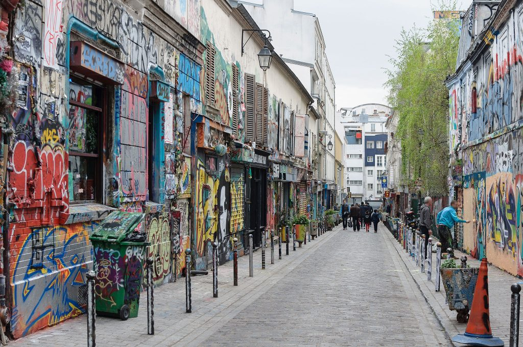 a street full of graffiti in Belleville, Paris