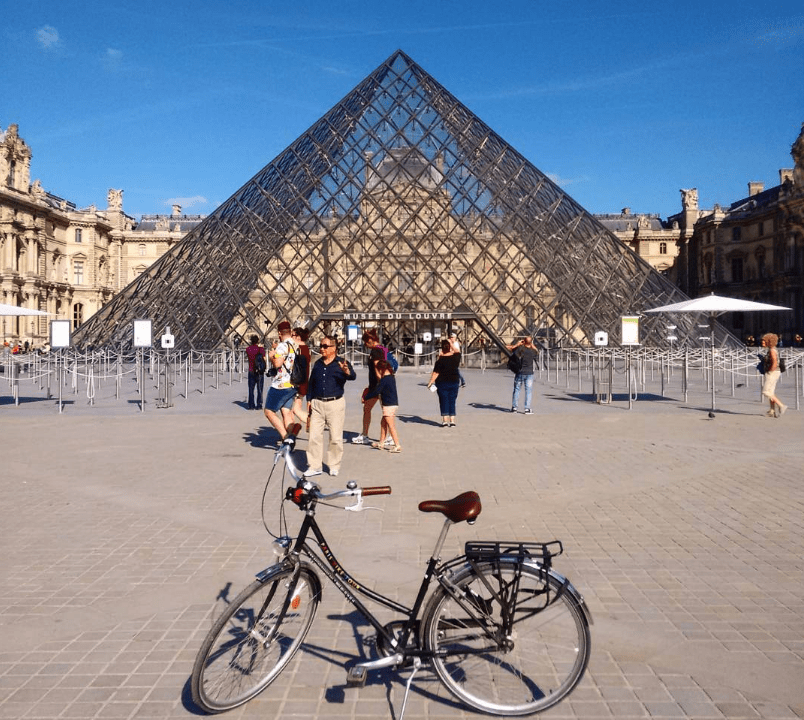 bike in Paris in front of the Louvre pyramides