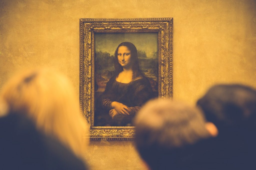 Visiting the Louvre - It's difficult to know who is watching who when visiting The Louvre: View of Mona Lisa painting in Louvre Museum