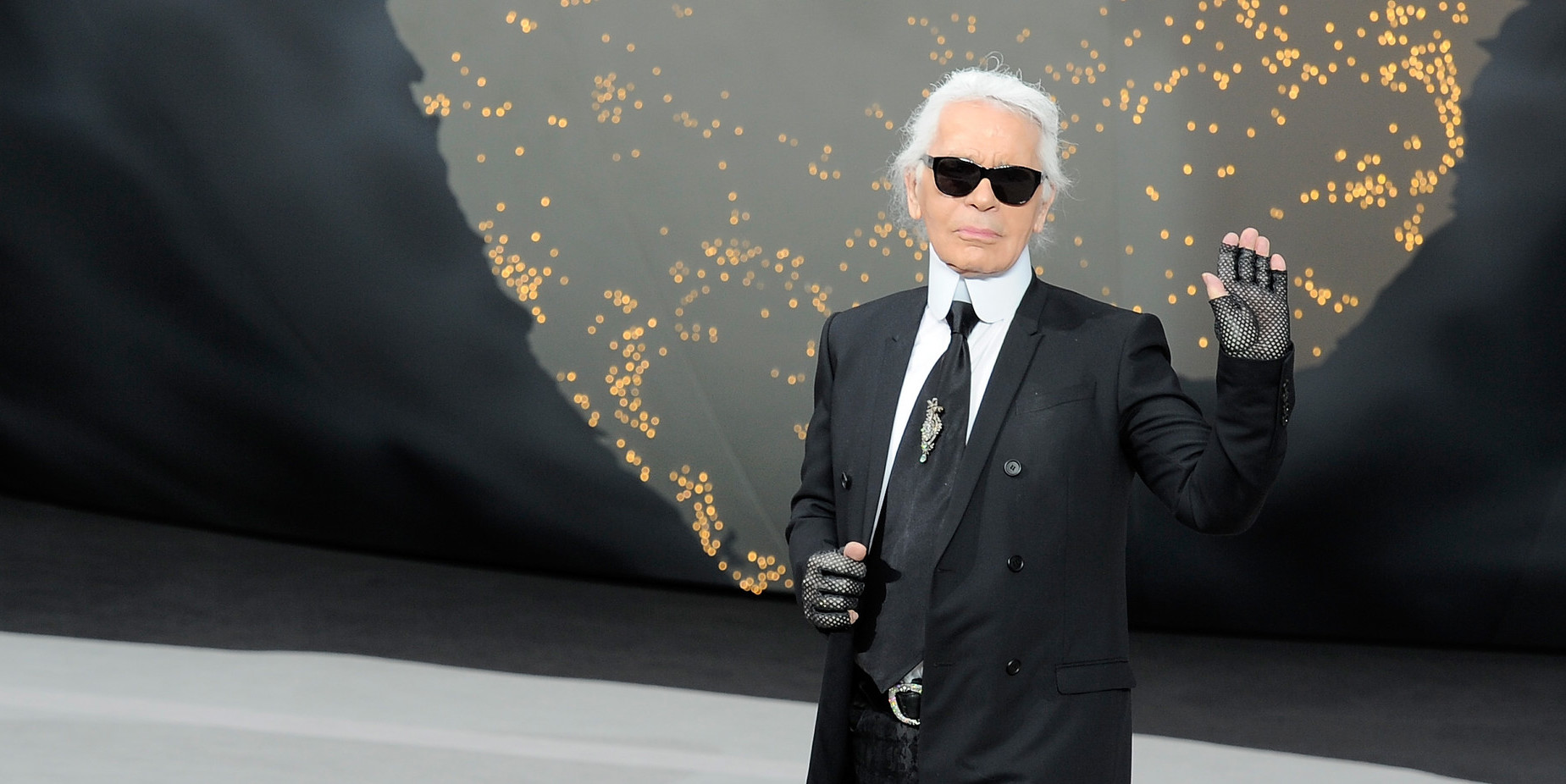 Karl Lagerfeld in a dior suit