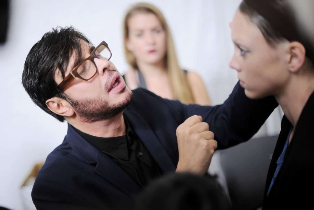 French makeup artists Francois Nars applying makeup backstage