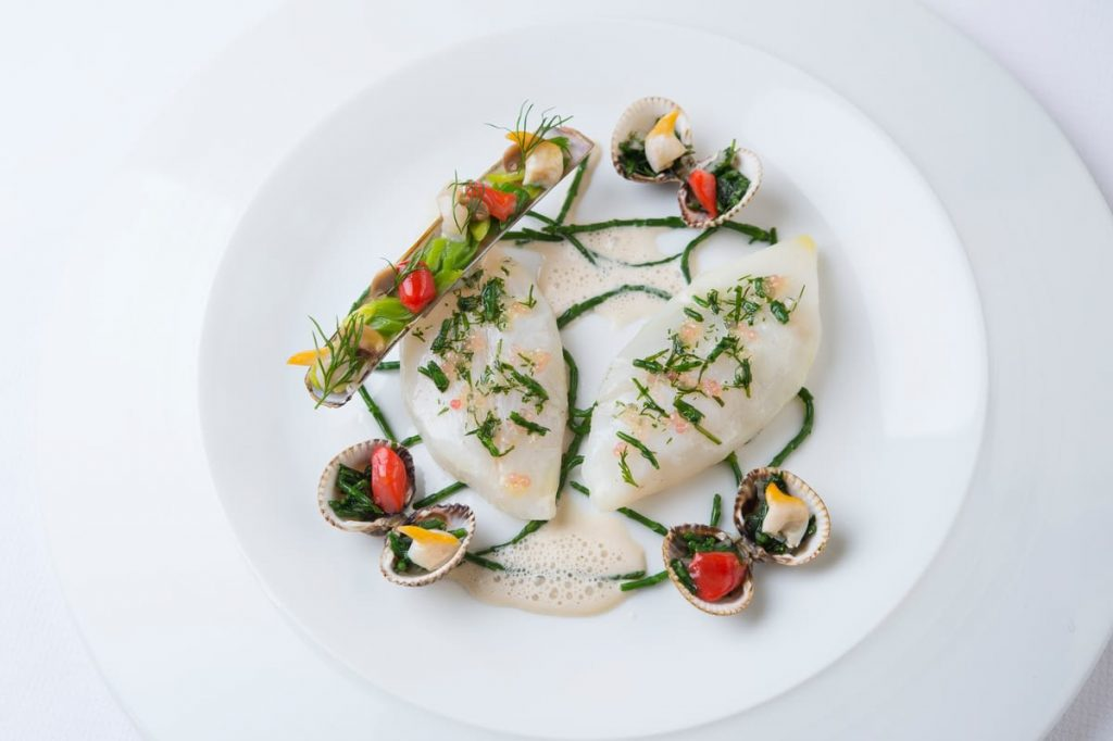 a seafood dish at Guy Savoy in Paris