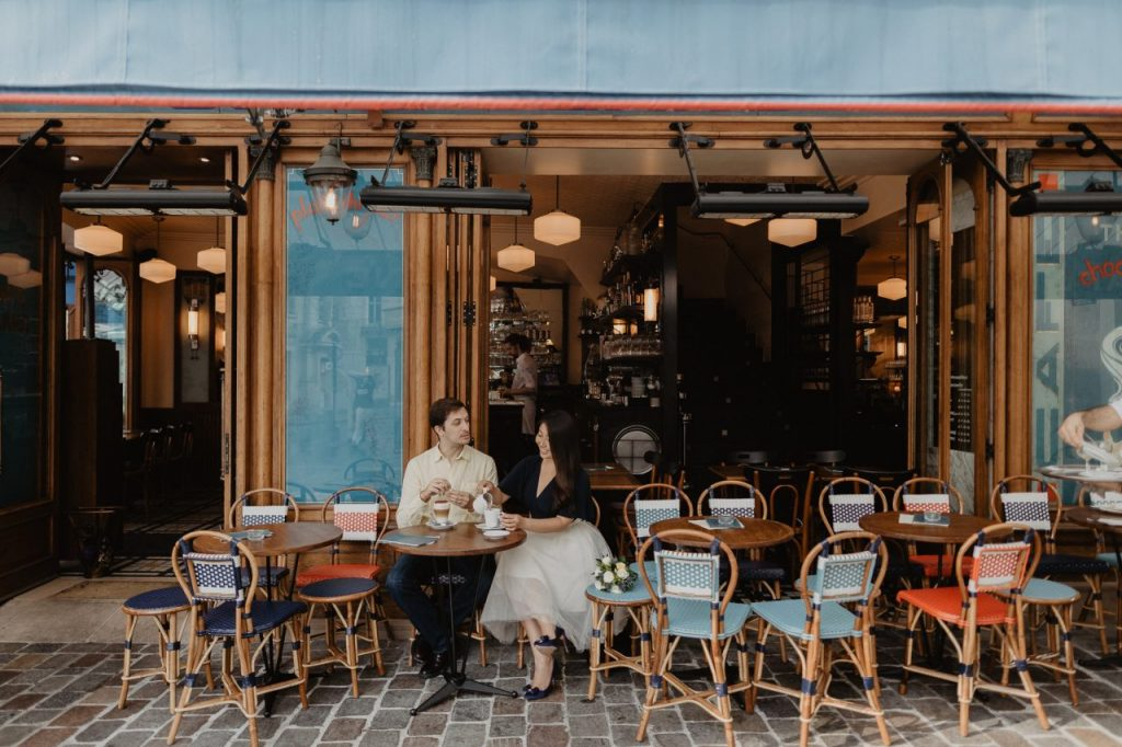 a couple sitting in a cafe in Paris
