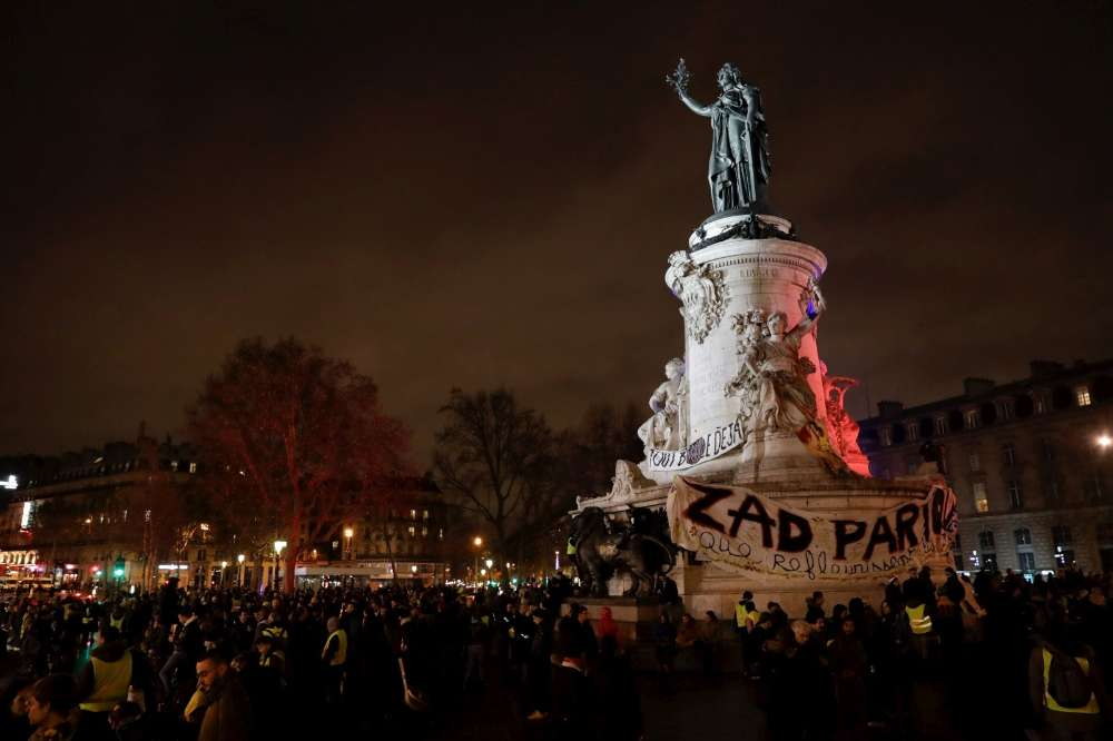 Yellow Vest protesters gathering at Place de la Republique at night