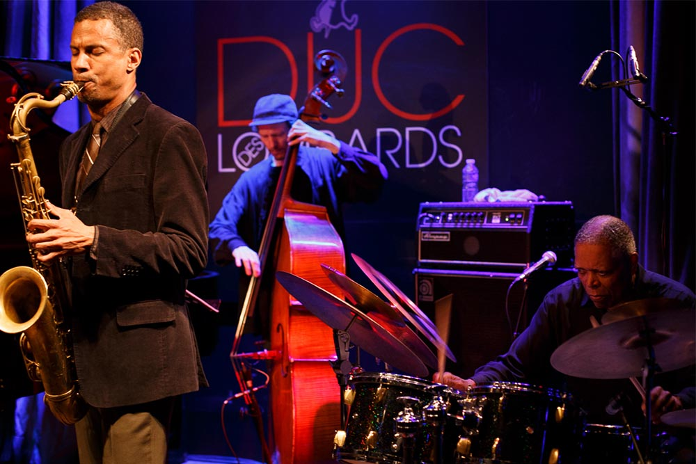 a jazz musician playing onstage at Duc des Lombards