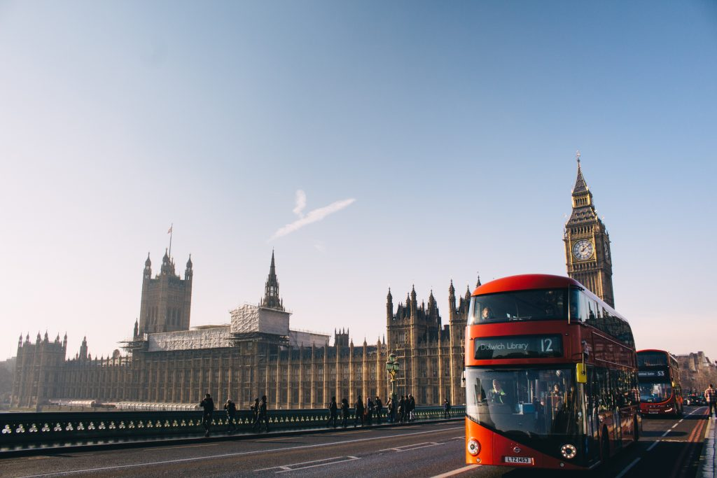 A double decker bus in London with the Big Ben in the background
