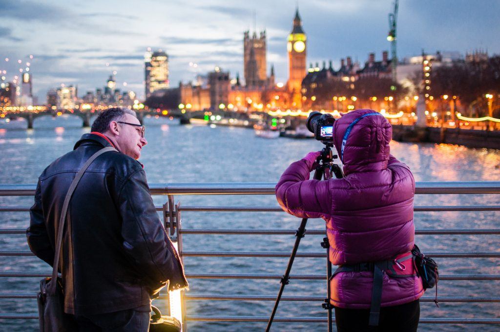 a stranger offering to take a photo is one of the tourist scams in London